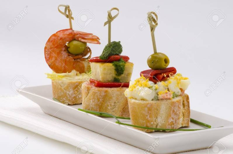 18653474-Spanish-cuisine-Montaditos-Sliced-bread-topped-with-a-variety--Stock-Photo.jpg