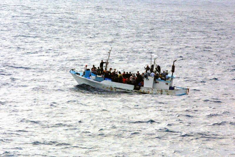 refugees-on-a-boat.jpg