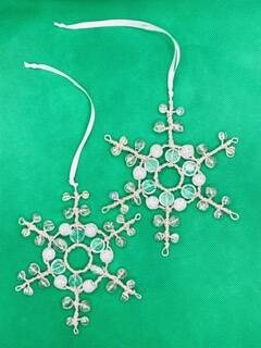 A pair of Snowflake Christmas decorations.