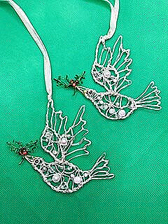 A pair of Dove Christmas decorations