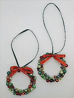 A pair of Christmas Wreath decorations.