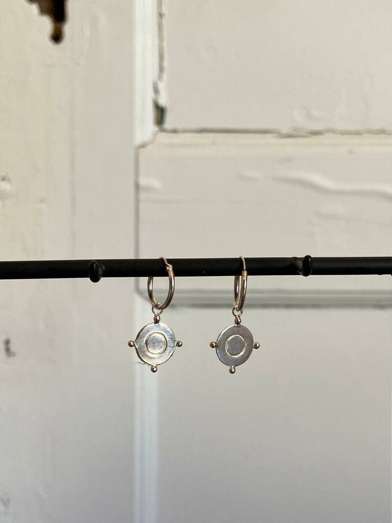 Silver compass earring