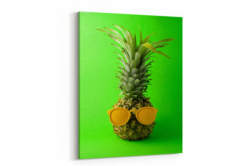 Pineapple with sunglasses as human face