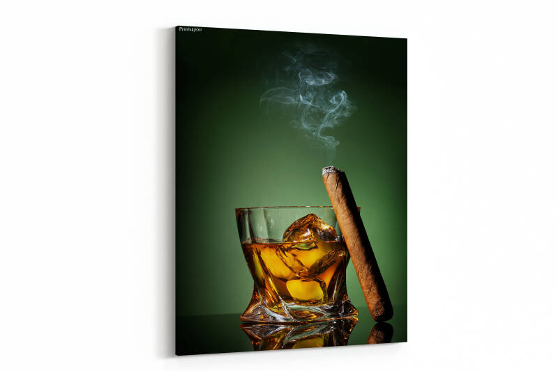 Whiskey and cigar on a green background