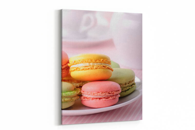 Pink, yellow, green macaroones on white plate