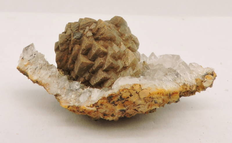 Geode with calcite on quartz with goethite needles from Morocco -miniature