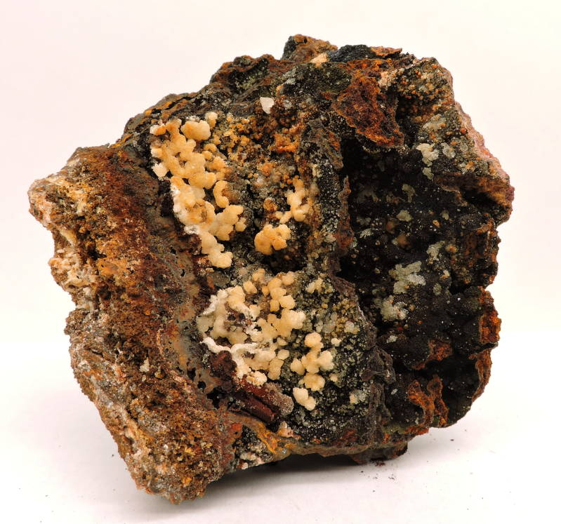Willemite, coronadite and ?? on limonite from Portugal - cabinet size