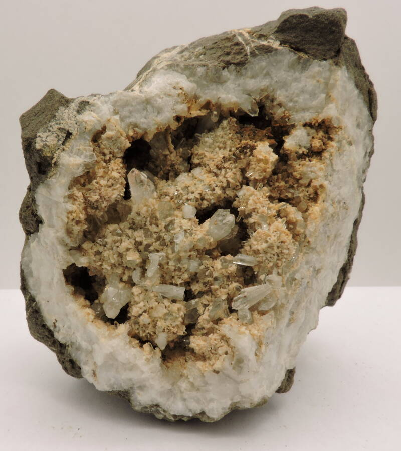 Geode with quartz and dolomite from Belgium - fluorescent - cabinet size