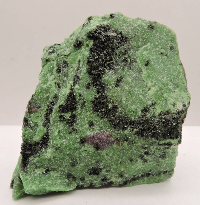 Zoisite, pargasite and corund var. ruby from Tanzania - fluorescent - cabinet size