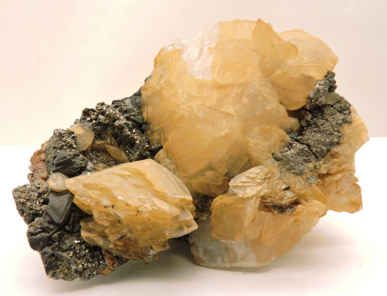Calcite with ilvaite and pyrite from Russia - fluorescent - cabinet size