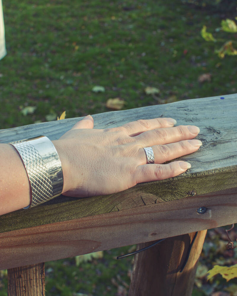 Solid wide silver bangle to impress