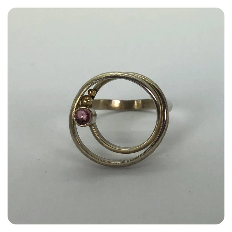 Silver ring with 18 ct golden details and pink tourmaline