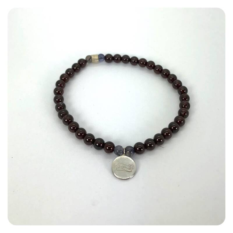 bracelet with grenade and iolite beads and a silver charm
