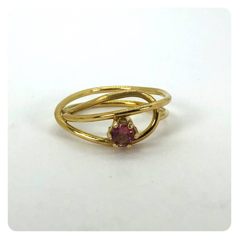 Yellow golden ring with a pink tourmaline