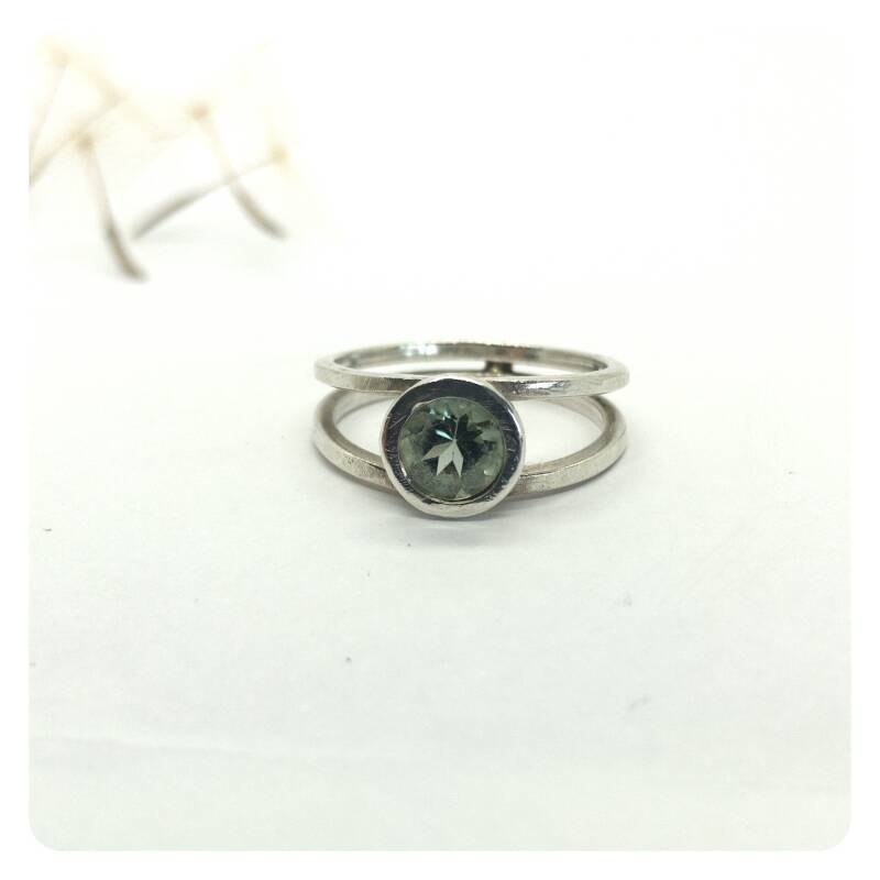 Silver ring with golden detail and green tourmaline