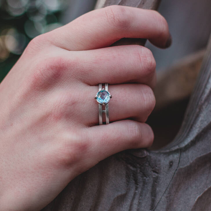Silver ring with double dome blue topaz