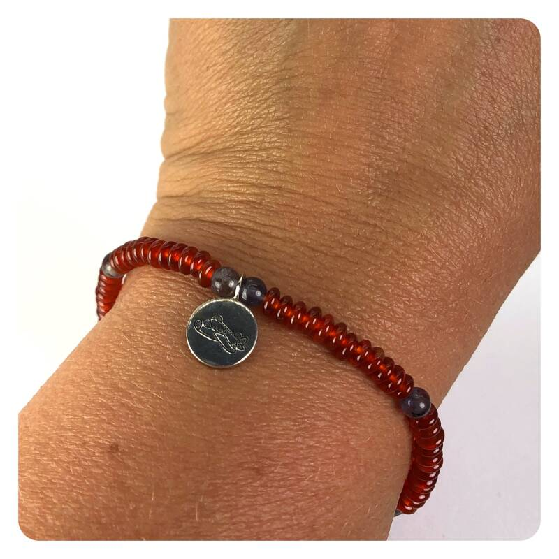 bracelet from carnelian and iolite beads and silver charm