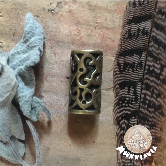 Brass colored tunnel bead