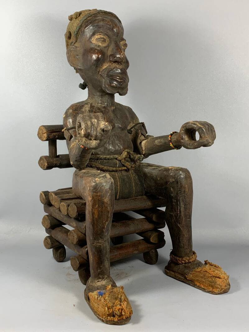 200931- Old and Tribal used Ekoi janiform statue sitting on a chair - Nigeria.