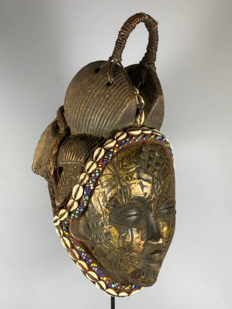 200703 - Tribal used Old African female mask from the Punu with Cap - Gabon.
