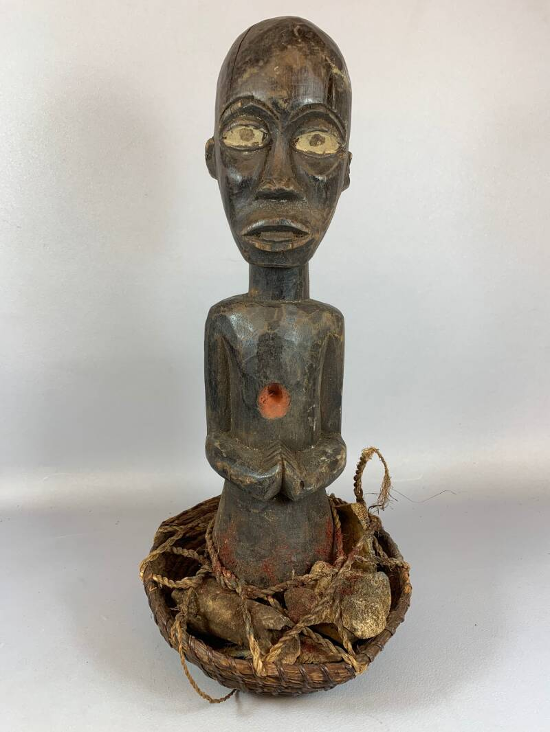 210255 - Tribal Used African IGBO statue in basket - Nigeria.