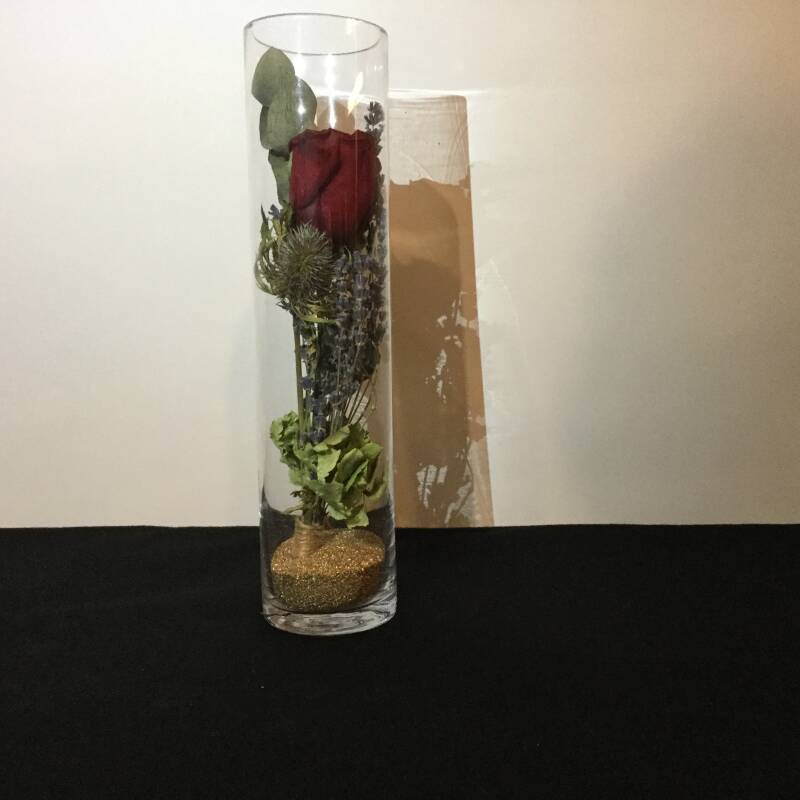 Red rose in glass