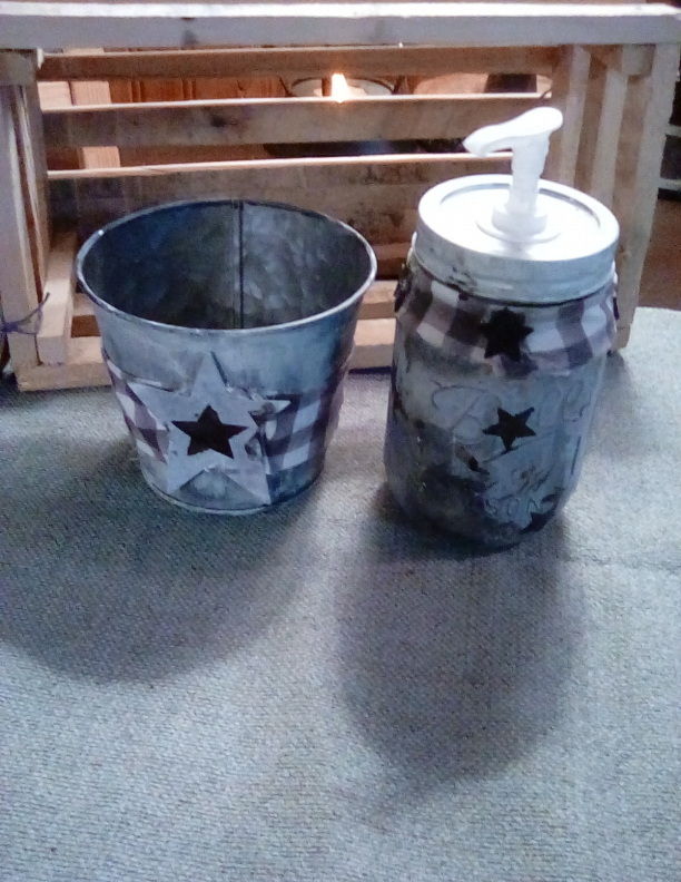 BLACK AND WHITE PRIMITIVE SOAP DISPENSOR  AND BUCKET