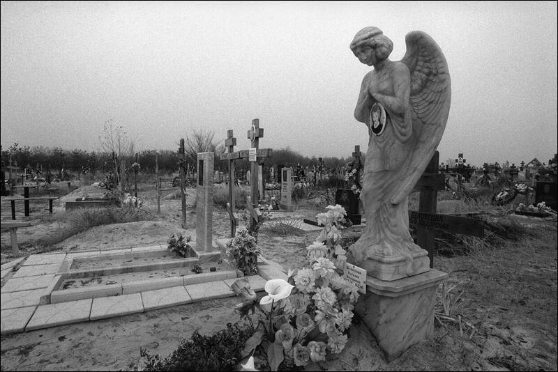 Tombstone sculpture of a angel on a cemetery in Surovikino