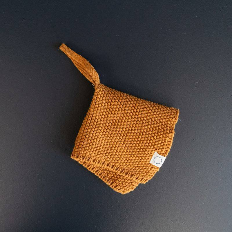 Coco & pine knitted pacifier hanger mustard