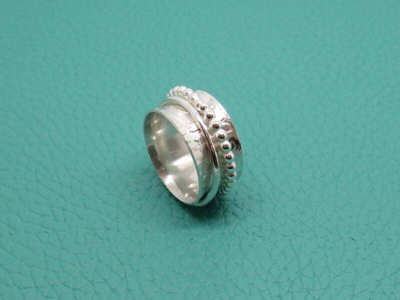 Silver spinnerring