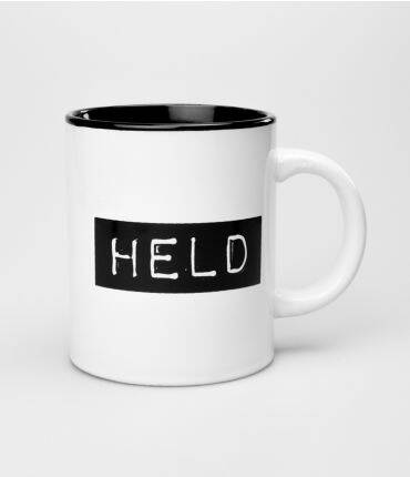 Held - black & white mug