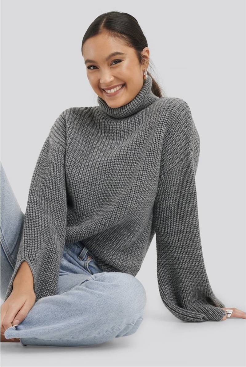 Sleeve slit knitted sweater