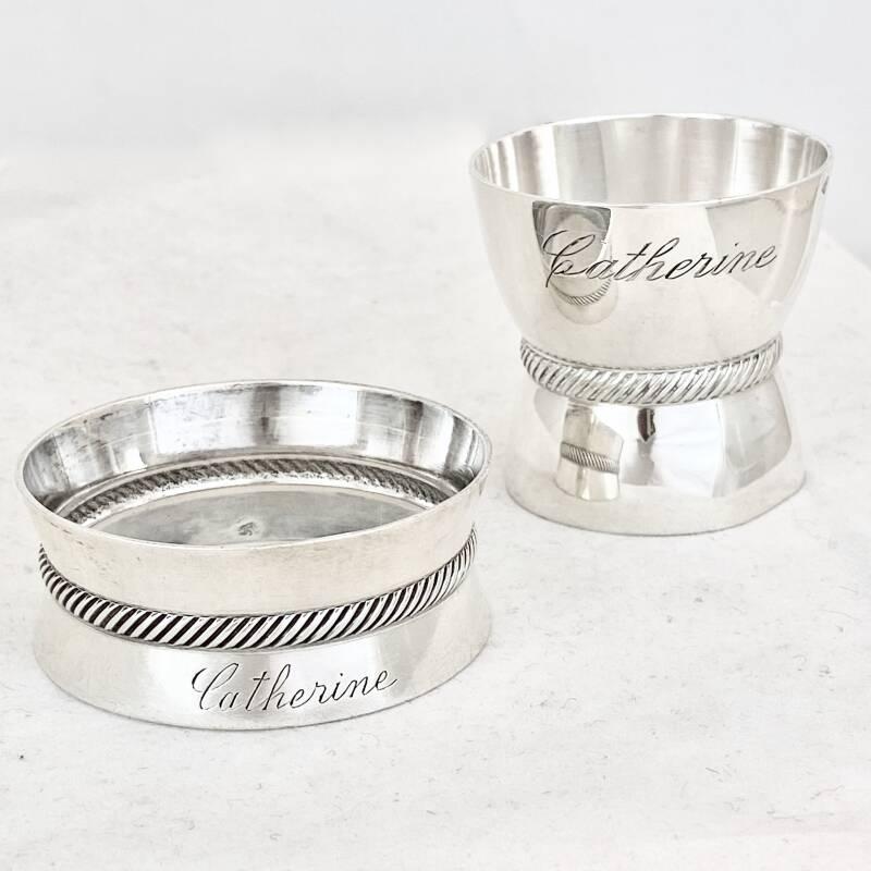 Set of egg cup and napkin ring in solid silver engraved with Catherine's name