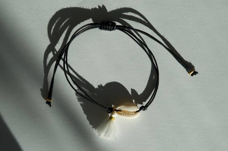 Black with shell and coin (gold)