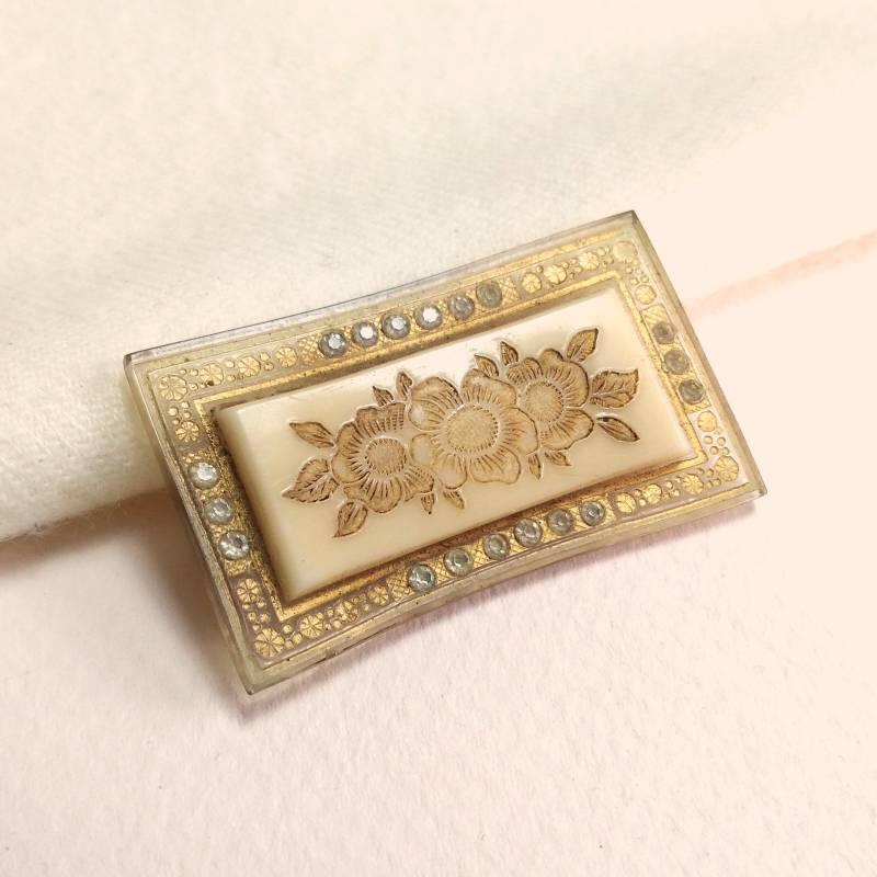 Celluloid Art Deco broche 20s