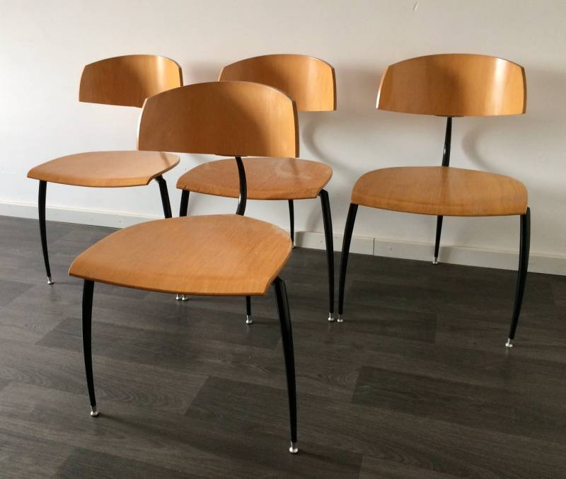 A set of 4 Midcentury Design 1970's Plywood & Metal 3 legged Chairs