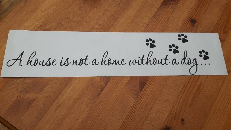 Muursticker A house is not a home without a dog""