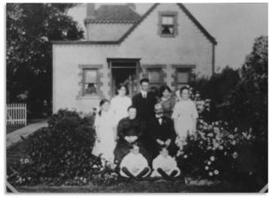Johannes Hijlkema #393, his wife Wilhelmina van den Anker # 401, and their family    before the house built by him in Dutch style in Buffalo NY- ca 1912.
