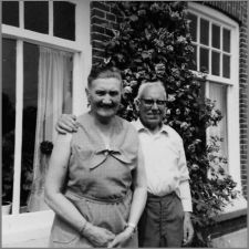 Agatha Vogelzang # 13 and husband Johannes Deden # 76 before their house in Hamersveld in which they had a little store and after their return from their emigration to the States. 1970.