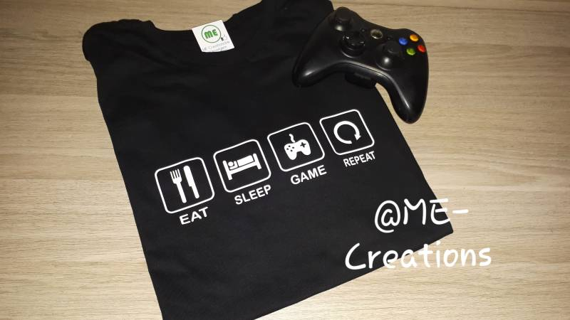 T-shirt 'eat sleep game repeat'