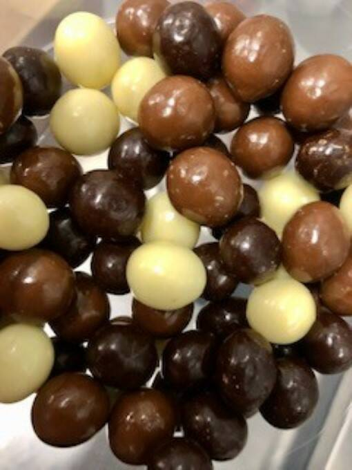 Chocolate coffee beans mixed.