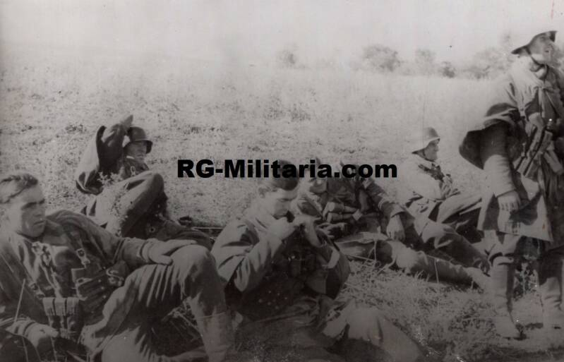 Photo - Soldiers resting with Steelgranades and MP40 pouches