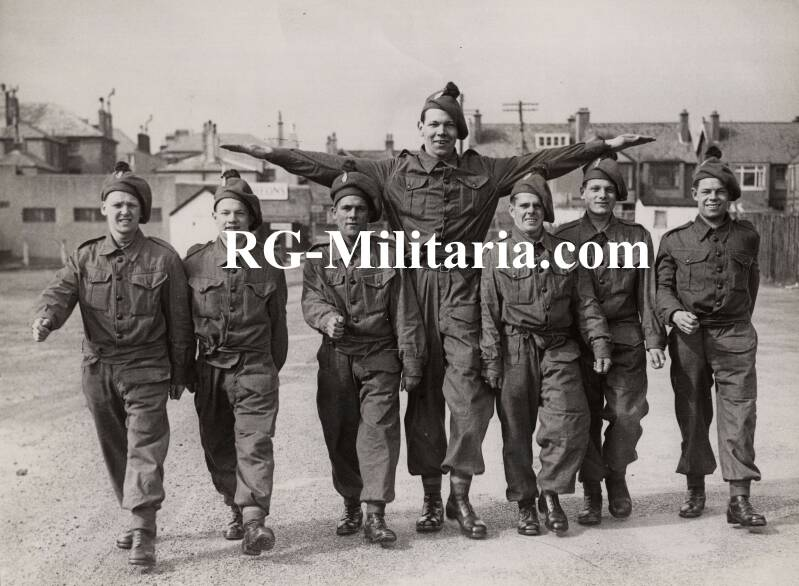 Press photo - British soldiers ''taking them under his ''wing'''' 4th of April 1940