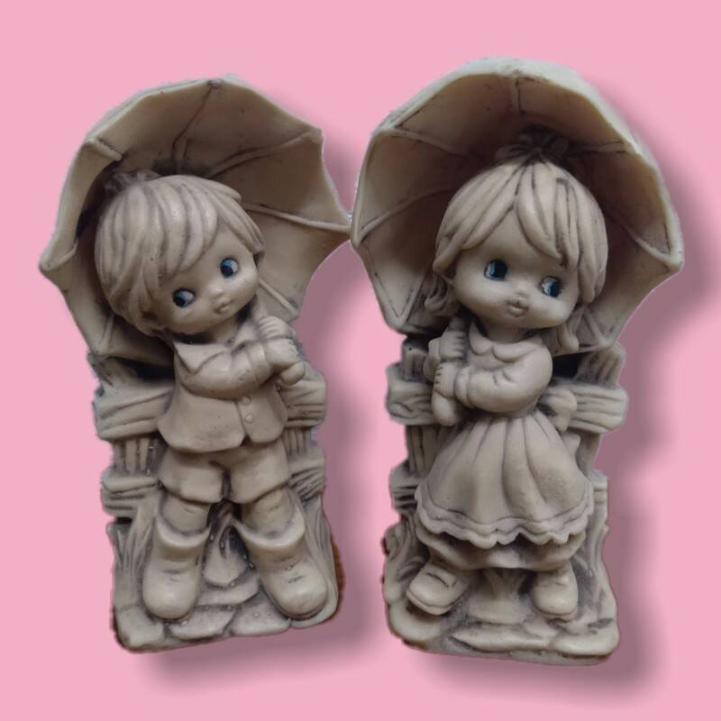 70´s Little boy and girl with umbrellas