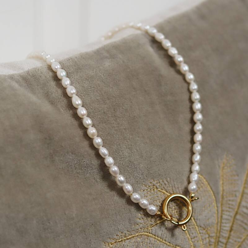 Golden pearl necklace
