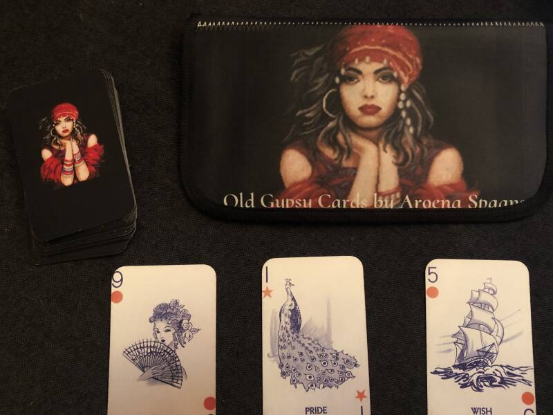Old Gypsy telling  cards  By Aroena Spaans