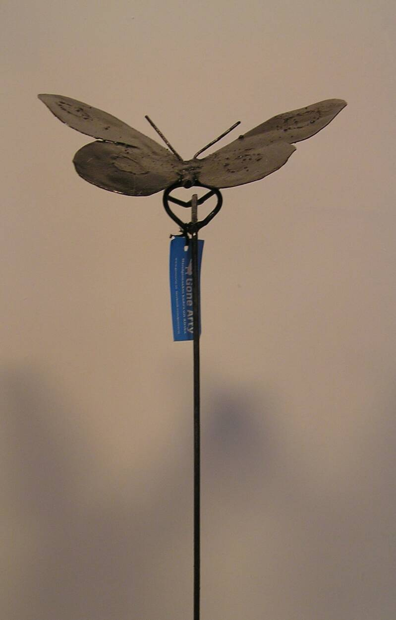 Metal butterfly on stick