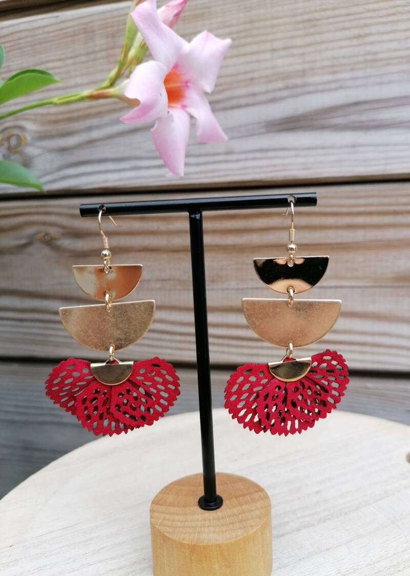 Gold and red earring