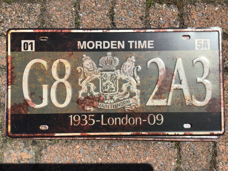 vintage replica numberplate: Morden time London