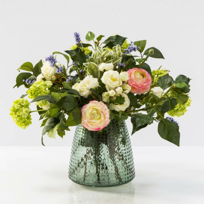 Glass vase with flower arrangement